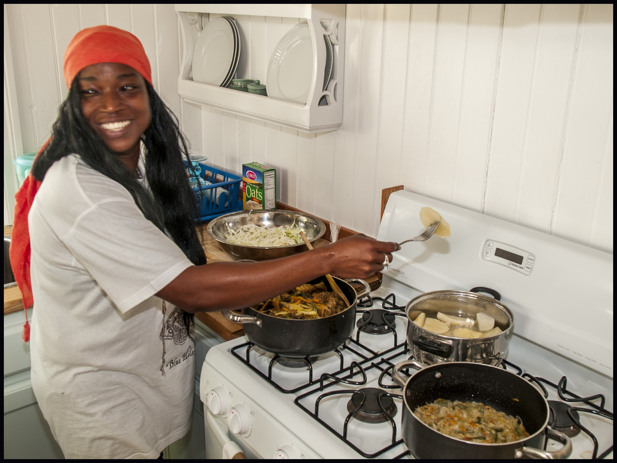 Sharna cooks for our guests at Blue Hole Cottage
